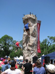 Adults climbing the wall